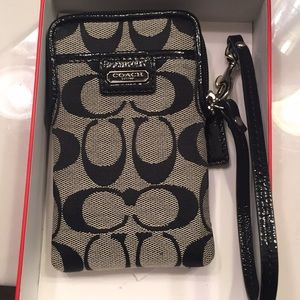 Coach wristlet - comes with box. Never used